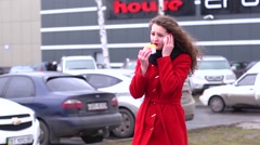 Young business woman negotiates a deal on the phone and eating a hamburger Stock Footage