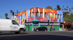 A building in downtown Los Angeles is brightly painted with murals and graffiti. Arkistovideo