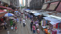 POV Point of view tram pass traditional market Hong Kong crowed shop shopper day Stock Footage