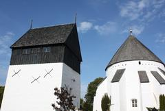 Osterlarskirke and freestanding tower Stock Photos