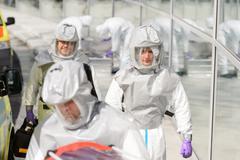 Biohazard medical team in protective uniform Stock Photos