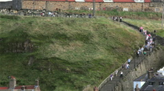 199 STEPS TO ST. MARY'S CHURCH & ABBEY, WHITBY, NORTH YORKSHIRE, ENGLAND Stock Footage