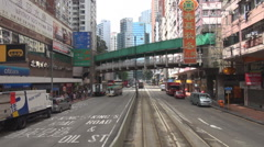 POV Point of view tram pass Hong Kong downtown crowded city cityscape car street Stock Footage