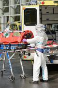 HAZMAT medical team member with stretcher - stock photo