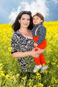 Beauty mother and toddler son in nature - stock photo