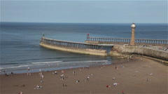 TWIN PIERS ENTRANCE TO HARBOUR, WHITBY, NORTH YORKSHIRE, ENGLAND Stock Footage