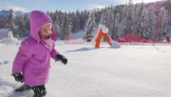 HD Slow-Mo: Cheerful Girl Running in the Deep Snow Stock Footage