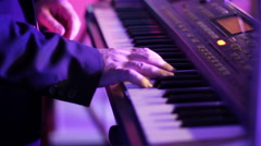 Musician playing on keyboards Stock Footage