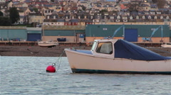 Boat Docked at a Buoy in a Harbor. Calm Sea & Teignmouth Port - Medium Shot Stock Footage
