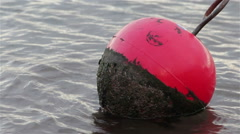 Gentle Sea Waves Lap Red Buoy and at Shaldon & Teignmouth Harbor Stock Footage