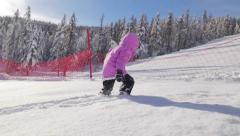 HD Slow-Mo: Little Girl Walking in the Powder Snow Stock Footage