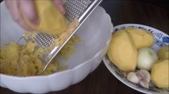 Prepare ingredients for potato pancakes Stock Footage