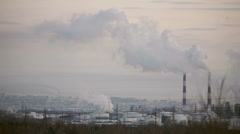 The smoke comes from the chimneys in winter, timelaps - stock footage