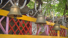 Bells at the wishing tree at Jyotirmath in Uttarakhand, India Stock Footage