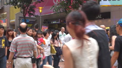 Crowded shopping street Hong Kong downtown modern market shop shopper tourism  Stock Footage