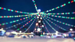 Rotating Illuminated christmas tree outdoor blurred - stock footage
