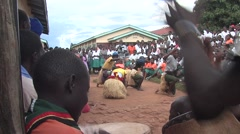 Traditional black people dancing outdoors in uganda - stock footage