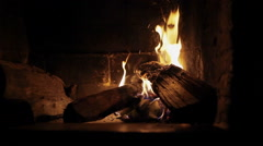 Wood burning in a fireplace on dark background with fire and flame. 3 shots - stock footage