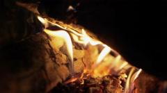 Bright burning wood, campfire macro video. Pan - stock footage