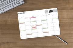 Calendar Kick-off today on wooden Table - stock photo