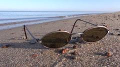 Sunglass eyeglass on summer resort sea beach Stock Footage