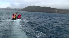Spanish scientists driving away in speedboat Stock Footage