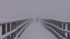 Dark mystical early morning fog on  wooden bridge and people silhouette Stock Footage