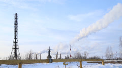 Large valve of the gas pipe, the smoke comes from the chimneys, timelaps Stock Footage