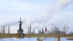 Large valve of the gas pipe, the smoke comes from the chimneys Stock Footage