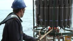 Scientist preparing oceanographic rosette CTD Stock Footage