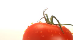 Red tomato rotates into and out of frame - stock footage