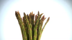 Bunch of asparagus spear tips rotate in frame Stock Footage