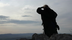 Female Adventurer standing on mountain top - stock footage