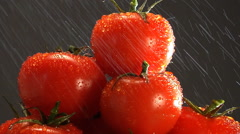 Stack of red tomatoes under gentle sprinkle of water rotate in frame Stock Footage