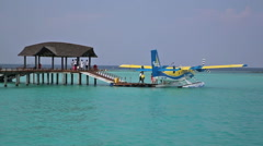 MALDIVES - 15 OCT 2014: Sea plane passengers arriving on vacation. Stock Footage