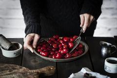 Prepping cherries Stock Photos