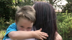 Four year old boy cuddling and loving mother Stock Footage