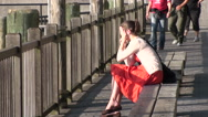 Stock Video Footage of South Street Seaport NY woman talking #170
