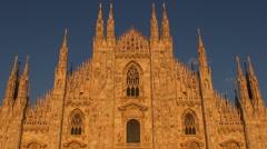 Timelapse sunset nightfall Millan Duomo Cathedral orange sunlight tourism iconic Stock Footage