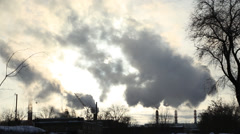 The smoke comes from the chimneys in winter, timelaps Stock Footage
