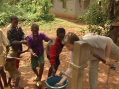 Childrens Bantus playing with a european men Stock Footage