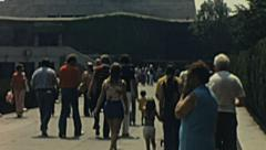 New York 1976: people walking to the Statue of Liberty - stock footage