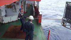 Scientist preparing oceanographic rosette CTD - stock footage