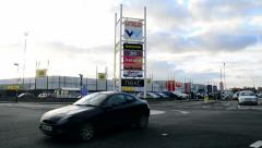 Vehicles Go in and Out of a Retail Park Stock Footage