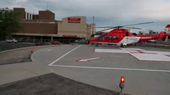 Life flight helicopter on landing pad Stock Footage