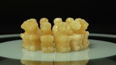 Carved aragonite monkeys rotating Stock Footage