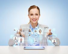 Businesswoman with tablet pc and icons of contacts Kuvituskuvat