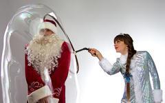 Photo funny Santa and snow maiden with soap bubble Stock Photos