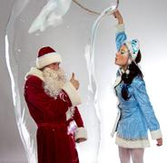 Image of happy Santa insede the soap bubble - stock photo