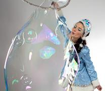 Image of snow maiden with long soap bubble Stock Photos